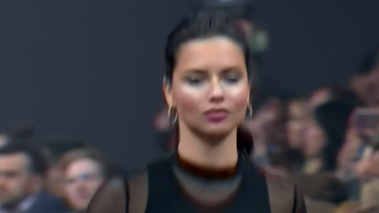 Adriana Lima struts down the catwalk for Maybelline in Berlin
